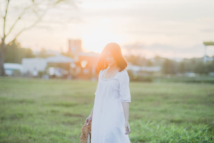 One Person Standing Young Adult Focus On Foreground Women Field Nature Grass Land Leisure Activity Adult Sky Sunset Real People Plant Lifestyles Young Women Hairstyle Day Outdoors Lens Flare Beautiful Woman