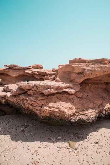 Oman Chapters Sky Clear Sky Rock Rock - Object Copy Space Nature Solid Blue Day No People Sunlight Rock Formation Beauty In Nature Scenics - Nature Tranquility Outdoors Physical Geography Tranquil Scene Land Geology Climate Arid Climate Eroded
