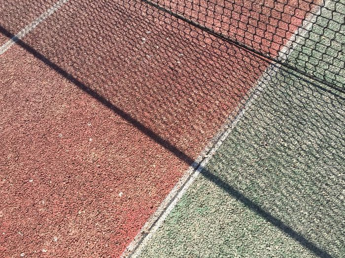 High Angle View Of Tennis Court On Sunny Day