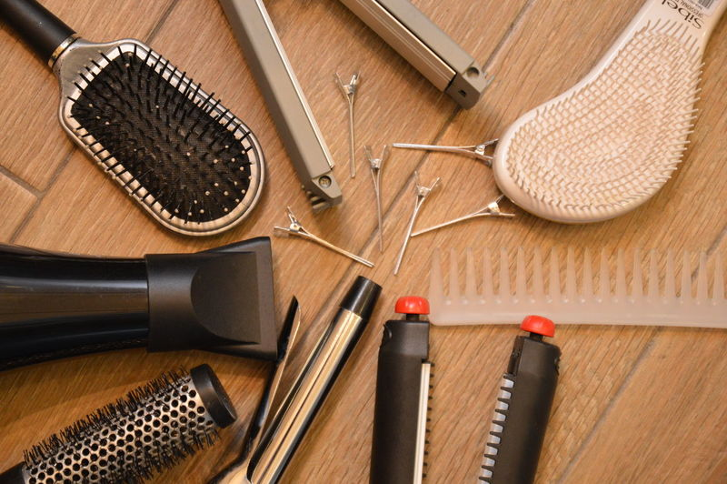 Close-up of hairdressing equipment on table