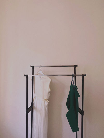 Close-up of clothes drying on clothesline against wall