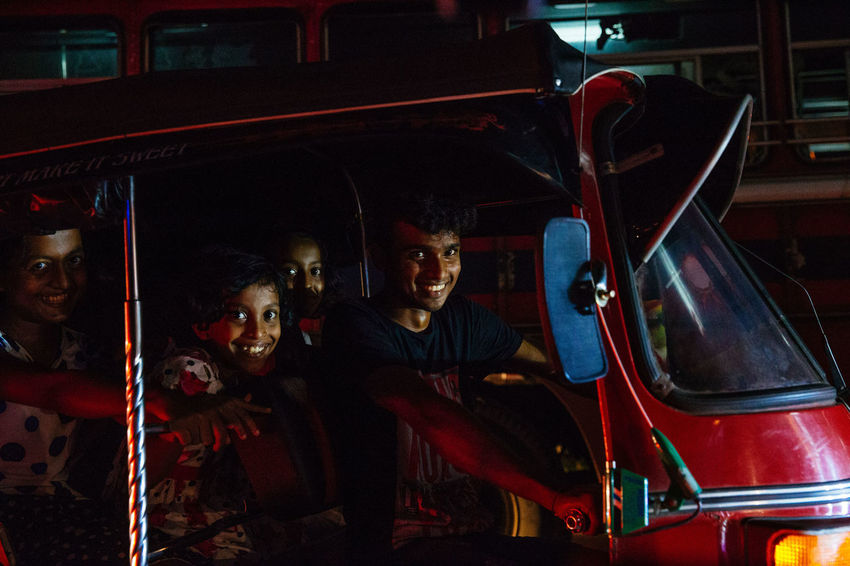 The streets were bustling and writhing with energy in Galle as Sri Lankans celebrated Vesak, the day of Buddah. Shooting from a Tuk Tuk in low light is extremely difficult in ever changing circumstances with light shifting every time traffic moves. Commuter Sri Lanka The Street Photographer - 2018 EyeEm Awards The Traveler - 2018 EyeEm Awards Front View Land Vehicle Leisure Activity Lifestyles Mode Of Transportation Motor Vehicle Portrait Real People Rickshaw Smiling Street Photography Transportation Tuk Tuk Vesak