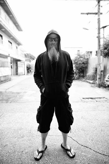 Full length portrait of man standing in city