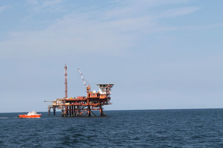 offshore oil and gas platform on the ocean Industry Water Nature Day Fuel And Power Generation Built Structure No People Outdoors Offshore Platform Platform Oil Green Color Sea Ocean Extraction