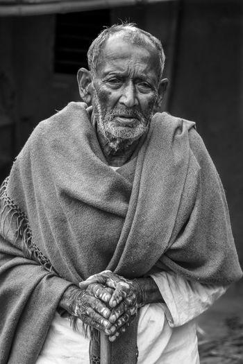 Portrait of senior man standing outdoors