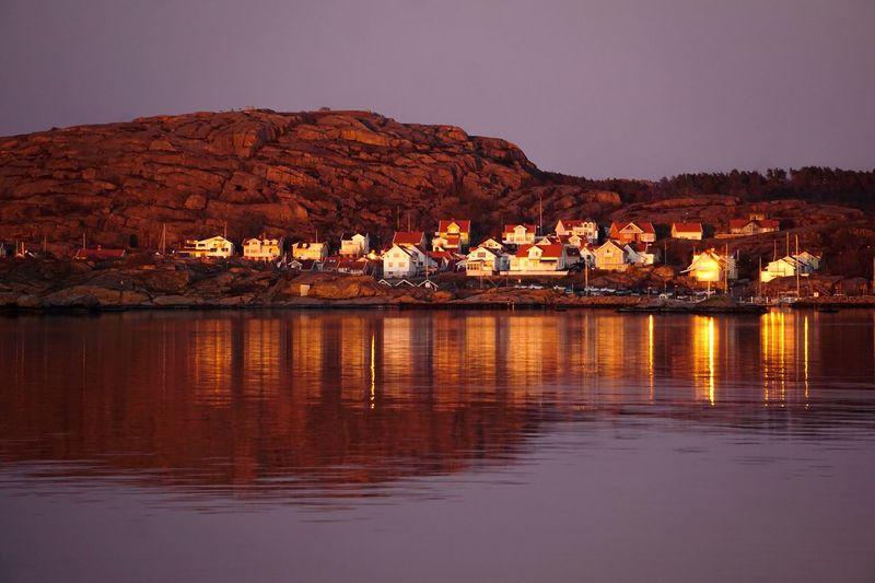 golden hour in Ramsvik , Sweden Reflection Reflections Reflections In The Water Golden Hour Village House Houses Settlement Light Sunset Water Lake Sunset Reflection Sky Lakeshore