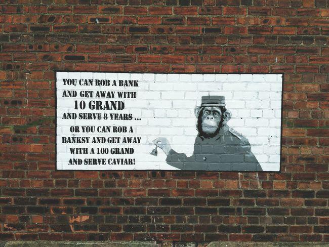 Banksy fights back Brick Wall Wall - Building Feature Text Communication No People Day Art Banksy Banksyart Banksystyle Chimp Monkey Chimpanzee Statement Graffiti Graffiti Art Justice Street Art