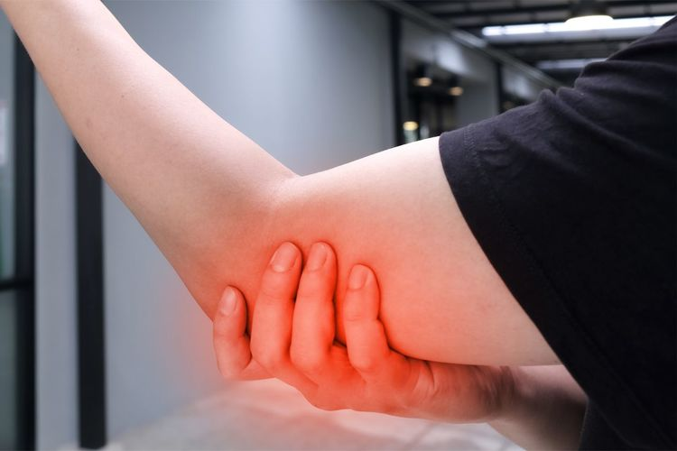 Close-up of woman touching hands