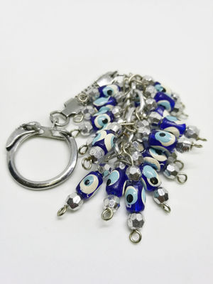 Closeup on tasbih or rosary and key chain from different countries on a white background with selective focus Calm DOA Japan Key West Las Vegas Planning Qibla Relaxing Tasbih Turkey USA Vacations Vegas  Adhesive Note Casual Clothing Eid Fujifilm Landscape Muslim No People Praying Qurban Religous Summer White Background