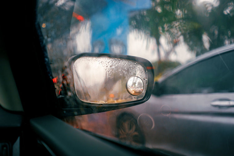 Car Car Interior Close-up Day Focus On Foreground Glass - Material Land Vehicle Mode Of Transportation Motor Vehicle Nature No People Outdoors Rain RainDrop Rainy Season Reflection Selective Focus Side-view Mirror Transparent Transportation Travel Vehicle Interior Vehicle Mirror Water Wet A New Perspective On Life Capture Tomorrow EyeEmNewHere