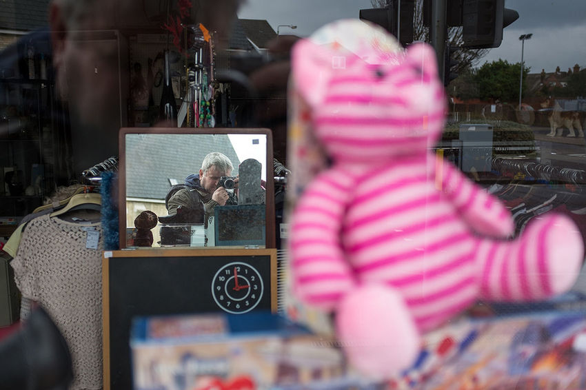 My own reflection in a mirror in the window of the Greyhounds in Need charity shop in Moordown. Out Walking Dorset Fujifilm Charity Shop