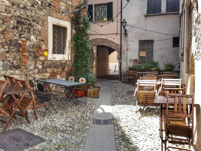 The morning after Hidden Corner My City Tables And Chairs No People Outdoors Urban Exploration Cobblestone Alley Historical City Centre Nightlife Archway Quiet Place  Architecture UrbanscapeUrbanspace Waiting For The Night Urban Perspectives Summer Time  EyeEm Explorer