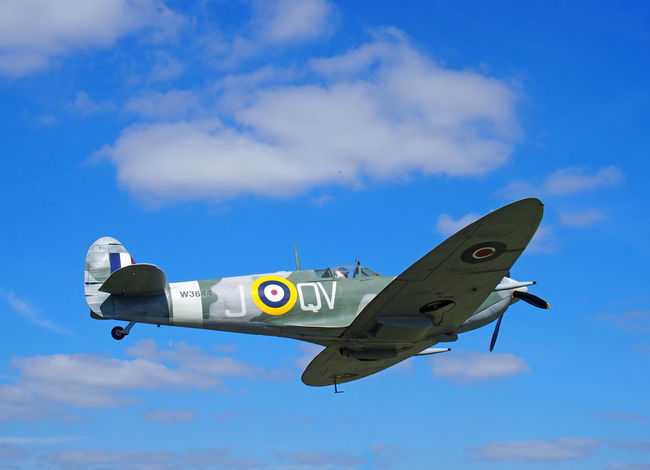 Vintage world war 2 Mark Vb spitfire in flight againt a blue sky with clouds British Spitfire Mk5b Air Force Blue Cloud - Sky Fighter Plane Flying Military Military Airplane Outdoors Plane Sky Spitfire Ww2