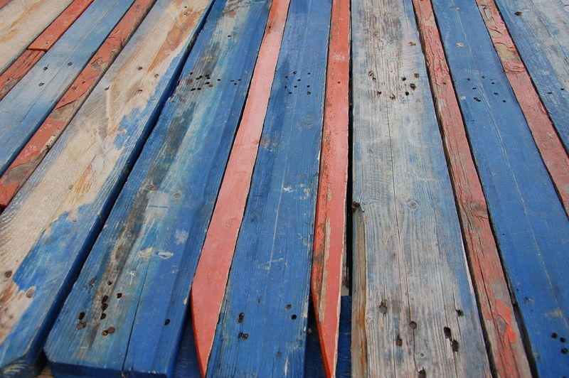Wood - Material Full Frame Close-up Outdoors Textured  Backgrounds No People Weathered Rusty Bad Condition Day Blue And Red Colour