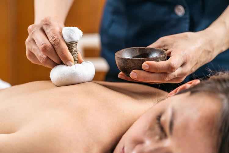 Kizhi ayurveda massage with herbal pads.