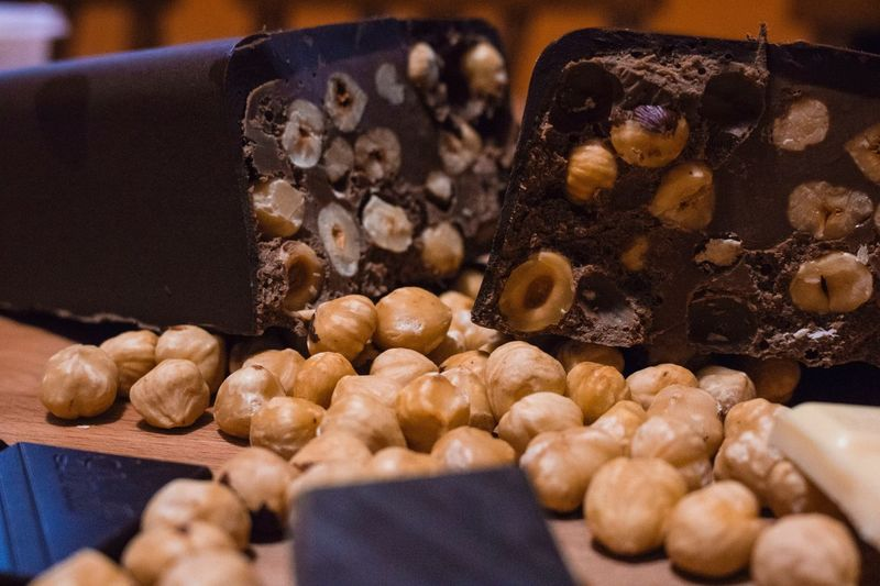 Close-up of chocolate bars with nuts on table