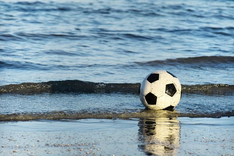 Stone ball on beach