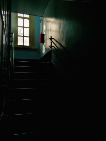 Absence Copy Space Dark Darkness And Light Illuminated Indoors  Light Light And Shadow Looking Through Window Low Angle View Mystery Narrow Pattern Railing Staircase Steps Steps And Staircases The Way Forward Wall Window