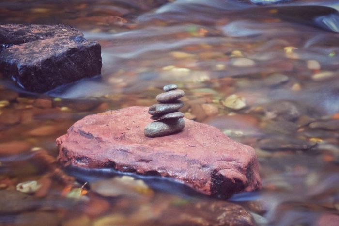 Motionless among the currents Close-up Rock Stone Focus On Foreground Selective Focus Day Outdoors Full Frame Rugged Non-urban Scene Tranquility No People Devil's Pulpit Scotland Pebble River Motion Stream Water