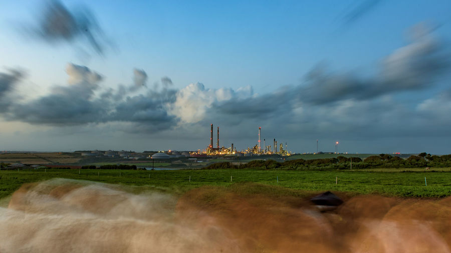 Moving cattle and industry in a Welsh landscape 16x9 Architecture Building Exterior Built Structure Cloud - Sky Day Factory Field Fuel And Power Generation Horizon Industry Landscape Long Exposure Nature Nature No People Outdoors Scenics Sky Wind Power