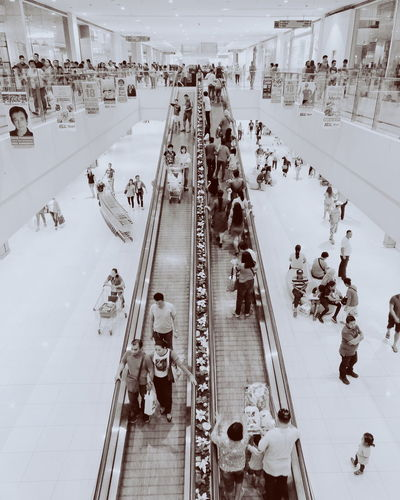 High angle view of people on escalator