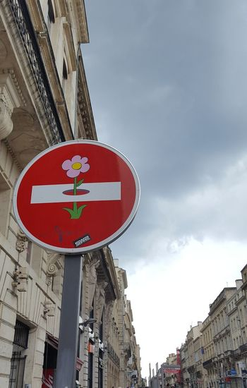 Bordeaux No People Cloudy Sky Low Angle View Clet Clet Abraham Street Art Street Photography Flower City Road Sign Red Communication Text Warning Sign Symbol Sky Architecture