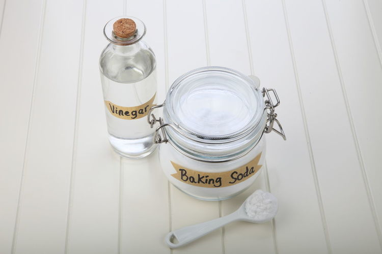 baking soda in the glass container Alkaline Anti Inflammatory Baking Soda Bicarbonate Clear Sky Close-up Cooking Glass Container Heart Burn Ingredient Jar Label Medicine Neutralizer Sodium Bicarbonate Vinegar White Background White Vinegar