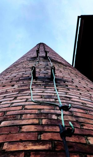 EyeEmNewHere Lightning Conductor Bricks Industrial Industry Chimney Low Angle View Built Structure Sky Brick Wall Architecture Building Exterior Cloud - Sky No People Outdoors Day Close-up EyeEm Ready