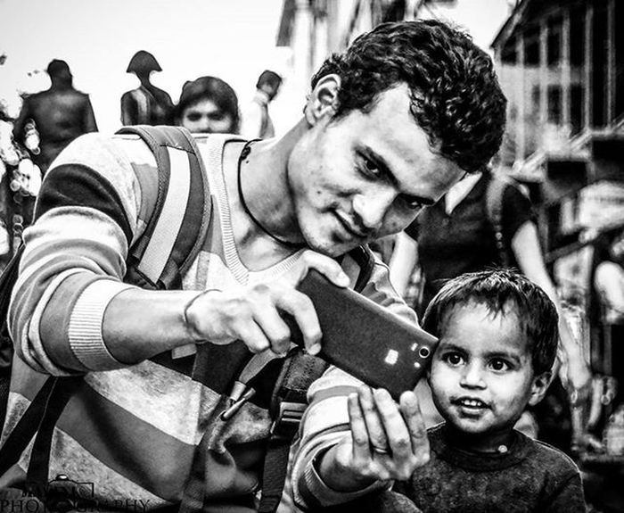 HERO He was facinated by mobile phone. He was happy while watching bollywood songs in the mobile of my friend Krishna. You can see the happiness in his eyes. I am in love with that cute smile.. Bnw Kid Poor  Birthday Tears Soi Mypixeldiary Thememorylane Wlni Love Sister Emotion Children Happiness Newdelhi Delhi Instagram Portrait _soi Streetphotographyindia _oye Oyemyclick Indianphotography _soi streetphotographyindia _oye oyemyclick photographersofindia streetphotography streetportrait igglobalpeople bnw_india ngma