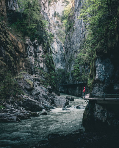 Woman standing alone in the deepness of the Aare gorge in Switzerland Aareschlucht Adventure Beauty In Nature Bern Deepness Gorge Gorgeous Leisure Activity Lonely Nature One Person Outdoors River Rock - Object Rock Formation Schlucht Schweiz Standing Suisse  Swiss Switzerland Tranquil Scene Tranquility Water Women The Great Outdoors - 2017 EyeEm Awards Go Higher The Traveler - 2018 EyeEm Awards