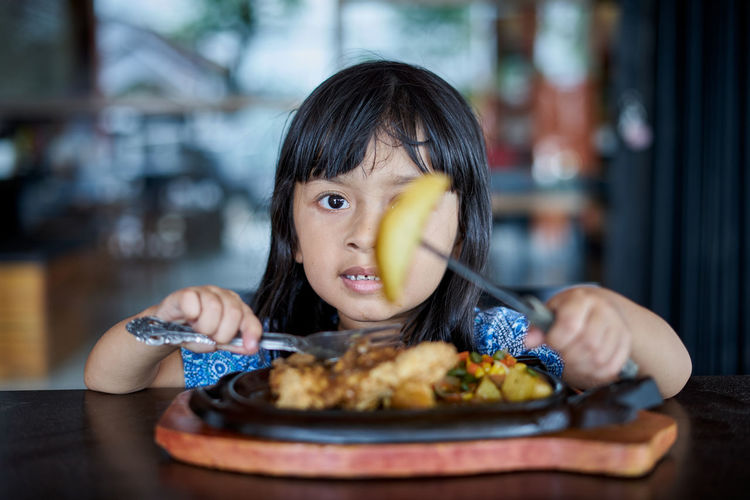 Portrait of girl eating food