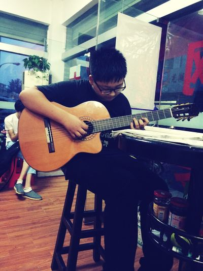 He love guitar and enjoy with playing it Enjoying Life