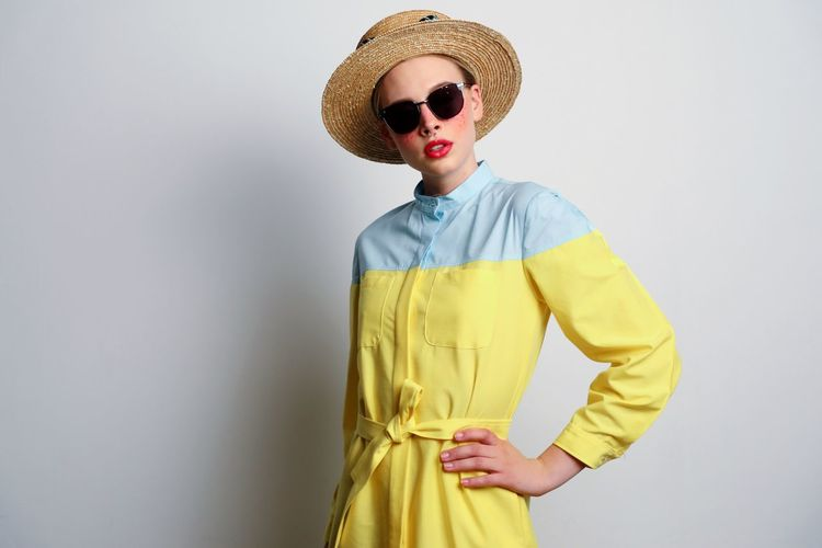 Summer ready fashion Fashion One Person Clothing Studio Shot Standing Indoors  Sunglasses Hat Glasses Portrait Young Adult Yellow Women Front View Wall - Building Feature Beautiful Woman Adult Three Quarter Length Dress Hand