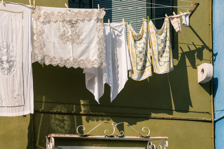 Architecture Burano, Venice Colors Italia Shadow And Light Travel Travel Photography Venezia Venezia, Italia Venice, Italy Burano Clothesline Clothespin Color Colorful Day Hanging Italy Lace Laundry No People Photography Shadow Streetscape Venice