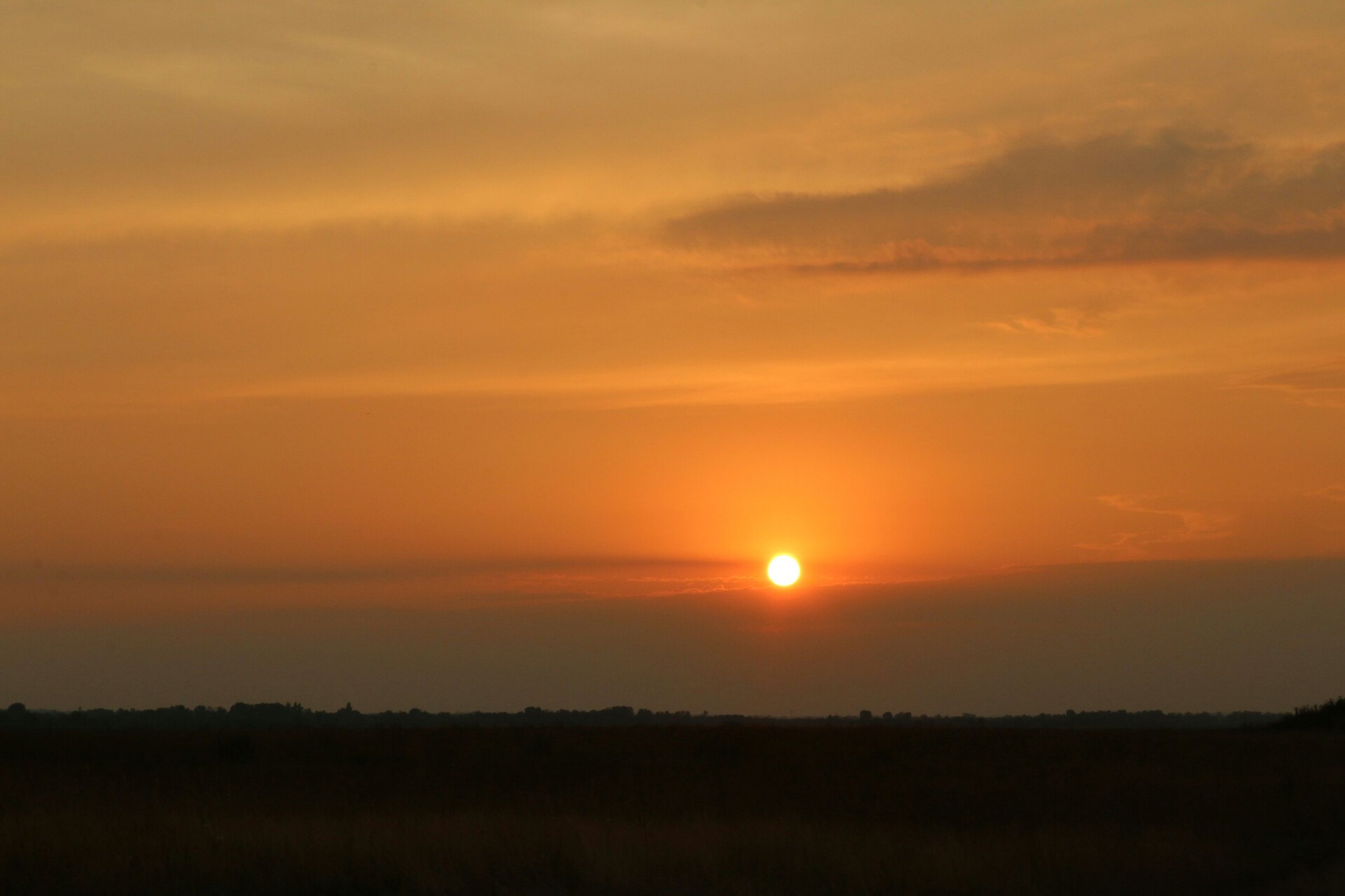 sunset, sun, orange color, scenics, tranquil scene, beauty in nature, tranquility, silhouette, sky, idyllic, nature, landscape, sunlight, cloud - sky, dramatic sky, majestic, outdoors, cloud, moody sky, no people