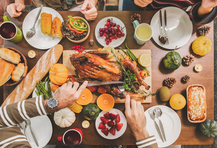High angle view of people served on table