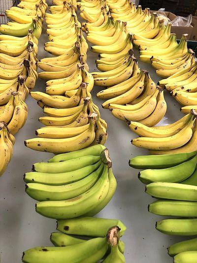 Stack of bananas at market stall