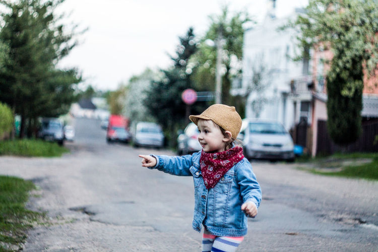 Belarus Minsk Casual Clothing Child Childhood City Clothing Cute Day Focus On Foreground Hat Lifestyles One Person Plant Real People Road Standing Transportation Tree