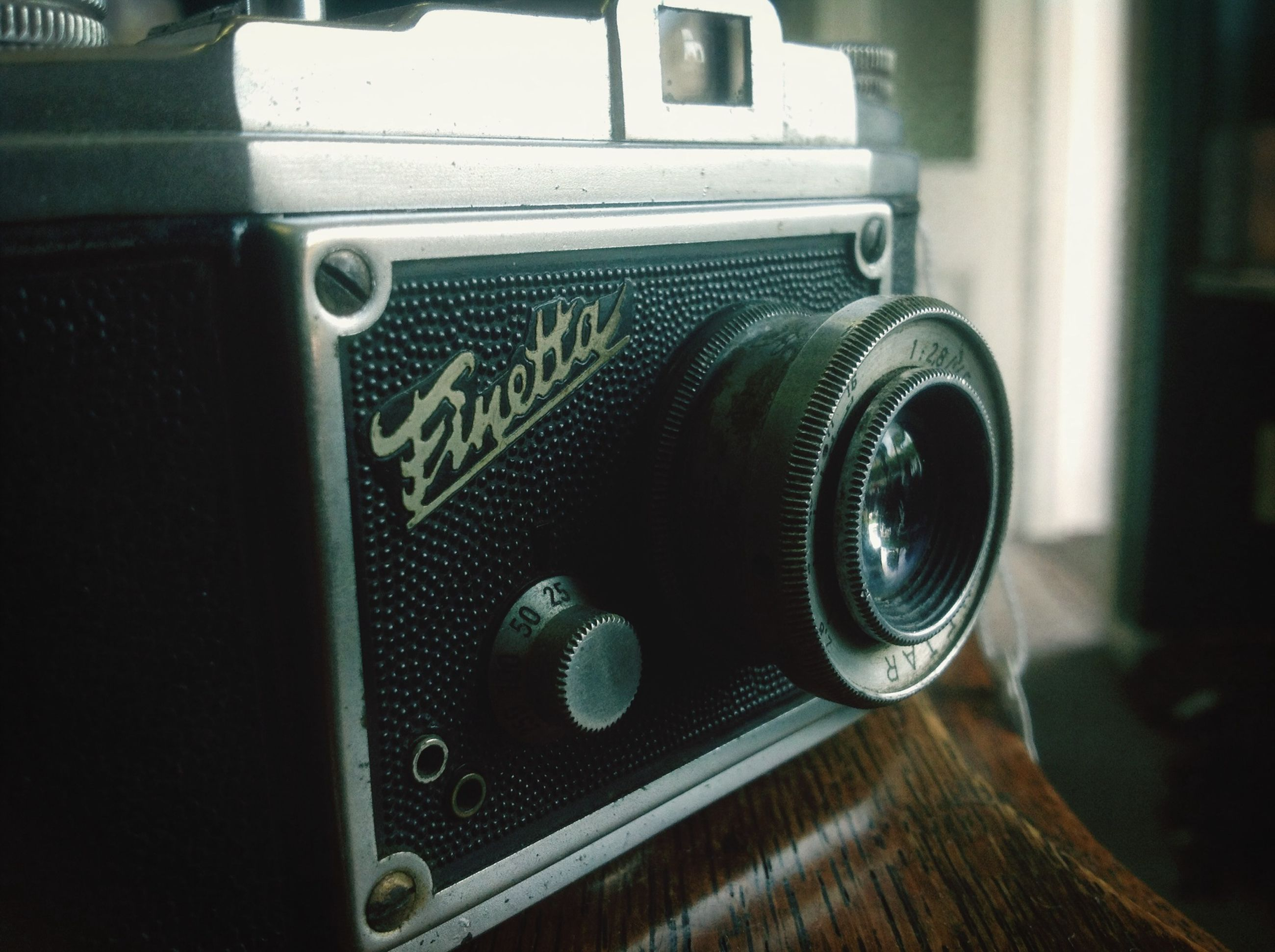 indoors, close-up, still life, technology, table, retro styled, old-fashioned, focus on foreground, equipment, selective focus, antique, metal, no people, old, photography themes, single object, vintage, home interior, high angle view, camera - photographic equipment