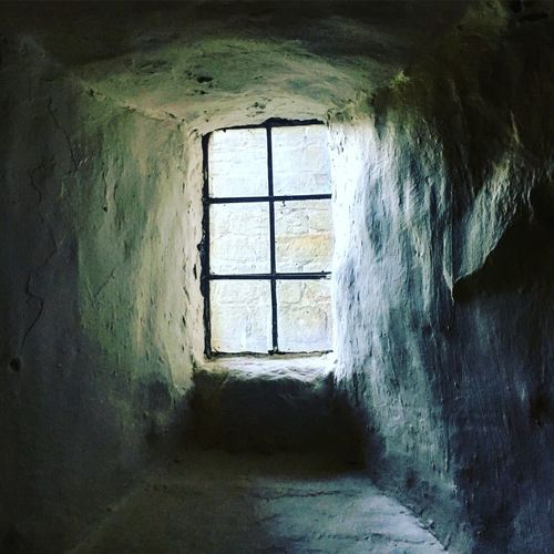 Castle window in a thick wall Castle Lumley Castle Window Architecture Building Built Structure Indoors  Abandoned Old Day No People Wall - Building Feature Glass - Material History Weathered