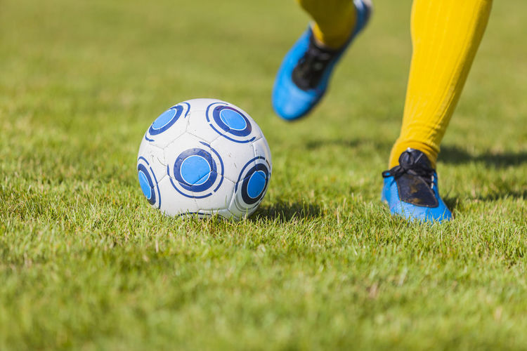 Dribbling Dribbling Football Kick Kicking The Ball Ball Body Part Dribble Grass Human Body Part Human Leg Kicking Leisure Activity Low Section One Person Playfield Soccer Soccer Ball Soccer Player Soccer Practice Sport