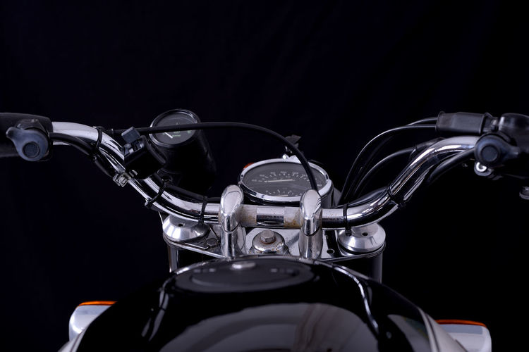 Close-up of bicycle against black background