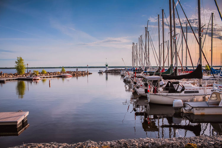 Pier with boats Yacht Boat White Green Blue Blue Sky Water Nautical Vessel Reflection Lake Sailboat Sky Landscape Boat Water Vehicle Dock Port Calm Harbor Sailing Sailing Boat Shore A New Beginning