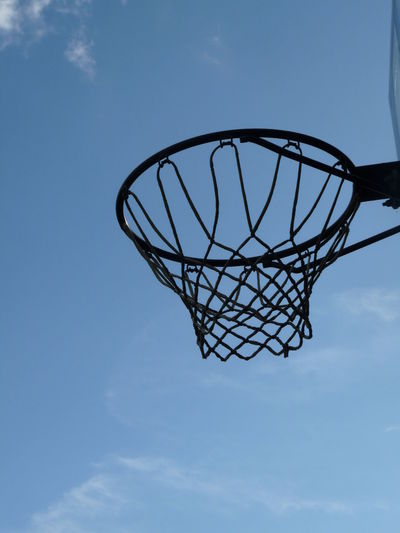 Basketball Basketball - Sport Basketball Hoop Blue Cloud - Sky Day Directly Below Geometric Shape Leisure Games Low Angle View Nature Net - Sports Equipment No People Outdoors Sky Sport Tranquility