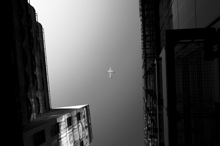 Looking up at the right moment sometimes pays off. Airplane Architecture Black And White Clear Sky London Noir Perfect Moment Plane Sihlouette Sky Monochrome Photography Welcome To Black