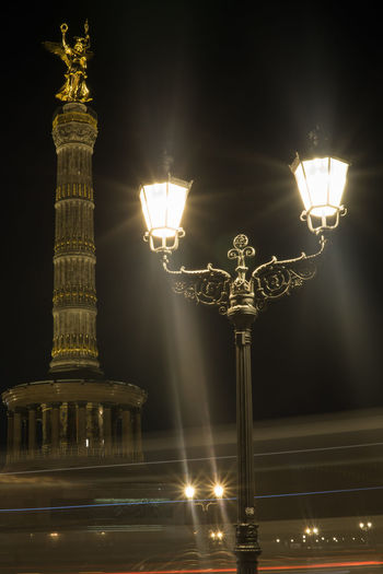 Statue of illuminated city at night