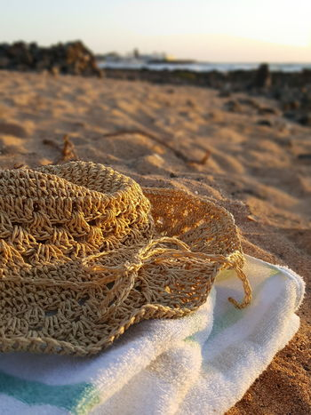 Beach Sand Sea Focus On Foreground Close-up Sunlight Vacations Sea Life Sun Hat Sun Shade Sun Shade And Beach Straw Hat Straw Hat Close Up Travelling Travelling Photography Travel Destinations Relaxing At The Beach