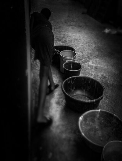 Girl collecting rain water. Girl Young Girl Rain Rainy Days Rain Water Bucket And Bowl Natural Water Lagos Lagosphotographer Who Busy Check This Out! Streetphoto_bw Photooftheday Streetphotography Follow4follow