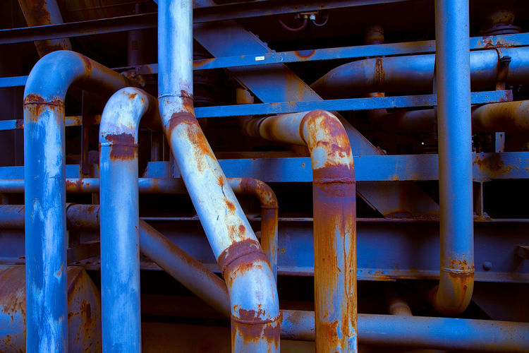 Urbex - 23 Metal Industry No People Factory Pipe - Tube Rusty Day Pipeline Close-up Indoors  Blue Backgrounds Full Frame Machinery Connection Pattern Business Pipe Iron - Metal