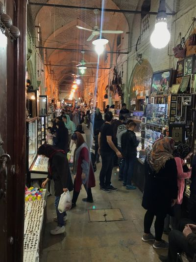 Retail  Illuminated Market Lighting Equipment Market Stall Choice For Sale Men Store Variation Real People City Hanging Bazaar Lifestyles Women Sale Built Structure Small Business Consumerism